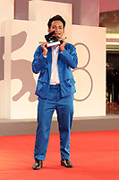 """VENICE, ITALY - SEPTEMBER 11: Director Neang Kavich poses, on behalf of Piseth Chhun, with the Best Actor Orizzonti Award for """"White Building"""" at the awards winner photocall during the 78th Venice International Film Festival on September 11, 2021 in Venice, Italy."""