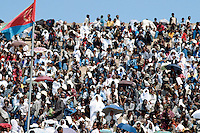 Eritrea. Asmara. September square. Meskel is the most important religious feast for the orthodox church in Eritrea. It takes place every year on september 27. The public is seated on the terraces while an eritrean flag  floats with a light wind. The crowd is a kaleidoscope of colors.  © 2002 Didier Ruef