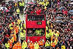 © Joel Goodman - 07973 332324 . 30/05/2011 . Manchester , UK . Fans line Deansgate in Manchester City Centre, as Manchester United Football Club hold an open-topped bus parade through the city. The team are celebrating winning the Premier League title for the nineteenth time . Photo credit : Joel Goodman