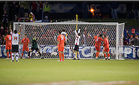 As Patrick Mullins (15) and Jordan Cyrus (14) of Maryland celebrate Cody Mizell (1) of Clemson holds his head in his hands after a goal is scored during the game at the Maryland SoccerPlex in Germantown, MD. Maryland defeated Clemson, 1-0, in overtime.  With the win the Terrapins advanced to the finals of the ACC men's soccer tournament.