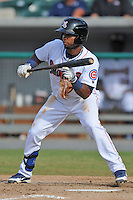 Tennessee Smokies second baseman Arismendy Alcantara #7 squares to bunt during game one of a double header against the Huntsville Stars at Smokies Park on July 8, 2013 in Kodak, Tennessee. The Stars won the game 2-0. (Tony Farlow/Four Seam Images)