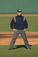 Umpire Taro Hamano works the bases during a Midwest League game between the Lansing Lugnuts and the South Bend Silver Hawks at Coveleski Stadium April 15, 2009 in South Bend, Indiana. (Photo by Brian Westerholt / Four Seam Images)