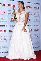 PASADENA, CA - SEPTEMBER 27: Gina Rodriguez poses in the press room during the 2013 NCLR ALMA Awards held at Pasadena Civic Auditorium on September 27, 2013 in Pasadena, California. (Photo by Xavier Collin/Celebrity Monitor)