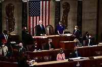 U.S. Vice President Mike Pence, center left, speaks as Speaker of the United States House of Representatives Nancy Pelosi (Democrat of California), center right, listens during a joint session of Congress to count the Electoral College votes of the 2020 presidential election in the House Chamber in Washington, D.C., U.S., on Wednesday, Jan. 6, 2021. Congress is meeting to certify Joe Biden as the winner of the 2020 presidential election, with scores of Republican lawmakers preparing to challenge the tally in a number of states during what is normally a largely ceremonial event. <br /> Credit: Erin Scott / Pool via CNP/AdMedia