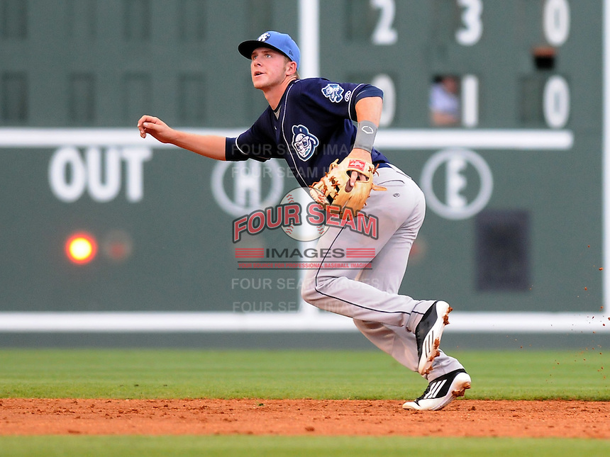 Shortstop Trevor Story (3) of the Asheville Tourists turns toward a pop up in a game against the Greenville Drive on May 14, 2012, at Fluor Field at the West End in Greenville, South Carolina. Asheville won 11-6. (Tom Priddy/Four Seam Images)