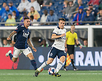 FOXBOROUGH, MA - JULY 18: Victor Giro #94 passes the ball as Diego Fagundez #14 closes during a game between Vancouver Whitecaps and New England Revolution at Gillette Stadium on July 18, 2019 in Foxborough, Massachusetts.