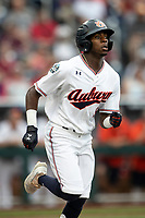 Auburn Tigers second baseman Ryan Bliss (9) runs to first base during Game 7 of the NCAA College World Series against the Louisville Cardinals on June 18, 2019 at TD Ameritrade Park in Omaha, Nebraska. Louisville defeated Auburn 5-3. (Andrew Woolley/Four Seam Images)