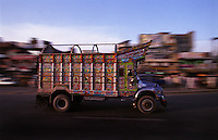 A decorated goods truck travels along the Grand Trunk Road at Dina.