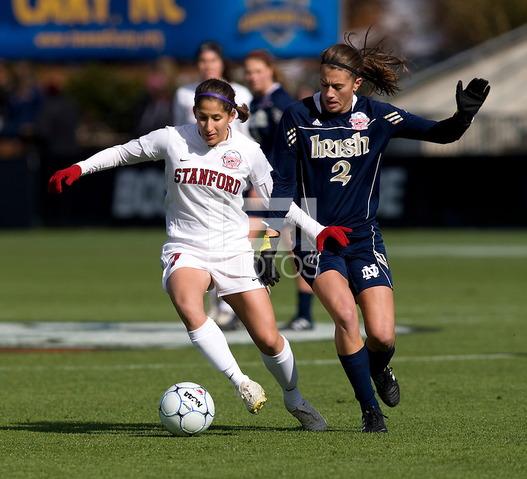 Teresa Noyola (7) of Stanford takes the ball away from Mandy Laddish (2)  of Notre Dame during the final of the NCAA Women's College Cup at WakeMed Soccer Park in Cary, NC.  Notre Dame defeated Stanford, 1-0.