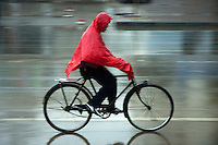 Man speeding on his bicycle under a storm, Datong, Shanxi, China.