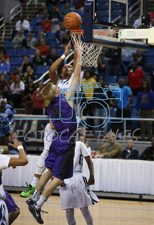 Canyon Springs' Gerad Davis shoots over Spanish Springs defender Kenny Meyer in a Division I semi-final game in the NIAA basketball state tournament at Lawlor Events Center, in Reno, Nev., on Thursday, Feb. 27, 2014. Canyon Springs won 66-51. (Cathleen Allison/Las Vegas Review-Journal)