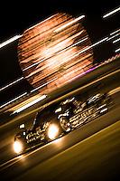 #55 Crown Royal-NPN Racing BMW/Riley of Christope Bouchut, Scott Tucker & Ed Zabinski, Sebastien Bourdais & Sasha Maassen at night.