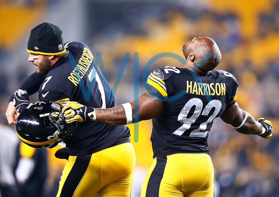Ben Roethlisberger #7 and James Harrison #92 of the Pittsburgh Steelers go through their pre game ritual prior to the game against the Indianapolis Colts at Heinz Field on December 6, 2015 in Pittsburgh, Pennsylvania. (Photo by Jared Wickerham/DKPittsburghSports)