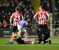 Lincoln City's Michael O'Connor receives treatment for an injury from Lincoln City's head of sports science and medicine Mike Hine<br /> <br /> Photographer Chris Vaughan/CameraSport<br /> <br /> The EFL Sky Bet League Two - Lincoln City v Exeter City - Tuesday 26th February 2019 - Sincil Bank - Lincoln<br /> <br /> World Copyright © 2019 CameraSport. All rights reserved. 43 Linden Ave. Countesthorpe. Leicester. England. LE8 5PG - Tel: +44 (0) 116 277 4147 - admin@camerasport.com - www.camerasport.com