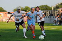 Allie Long (10) of Sky Blue FC is defended by Sophie Schmidt (8) and Sarah Huffman (14) of magicJack SC. Sky Blue FC and magicJack SC played to a 2-2 tie during a Women's Professional Soccer (WPS) match at Yurcak Field in Piscataway, NJ, on July 09, 2011.