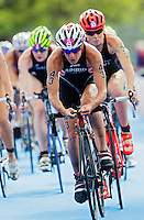 04 AUG 2012 - LONDON, GBR - Nicola Spirig (SUI) of Switzerland (right) cycles in the pack during the women's London 2012 Olympic Games Triathlon in Hyde Park, London, Great Britain .(PHOTO (C) 2012 NIGEL FARROW)