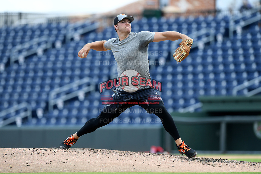 Baltimore Orioles pitcher David Hess delivers a pitch during a live-pitching workout with Major League and Minor League players from around the region on Friday, June 5, 2020, at Fluor Field at the West End in Greenville, South Carolina. Team workouts have been shut down during the coronavirus pandemic, so this group began working out in what they call game situation simulations a couple of days a week. (Tom Priddy/Four Seam Images)