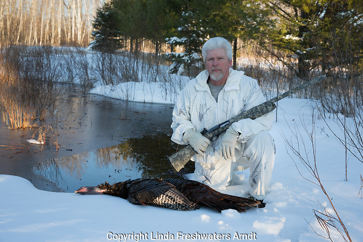Man with harvested eastern wild Turkey in spring