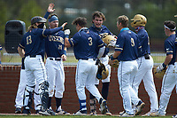 Riley Cheek (3) of the Queens Royals is greeted by teammates after hitting a home run against the Catawba Indians during game one of a double-header at Tuckaseegee Dream Fields on March 26, 2021 in Kannapolis, North Carolina. (Brian Westerholt/Four Seam Images)