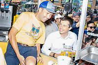South Bend mayor and Democratic presidential candidate Pete Buttigieg orders a Bacon Ball BLT at the Iowa State Fair in Des Moines, Iowa, on Tues., Aug. 13, 2019.