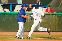 Art Charles #24 of the Bluefield Blue Jays shakes hands with manager Dennis Holmberg #34 as he rounds third base after hitting a home run against the Pulaski Mariners at Bowen Field on July 1, 2012 in Bluefield, West Virginia.  The Mariners defeated the Blue Jays 4-3.  (Brian Westerholt/Four Seam Images)