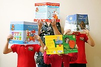 Pictured: Alice Morgan (TOP) with her children reading books. Friday 09 June 2017<br /> Re: Alice Morgan (NOT HER REAL NAME) who has spoken about her experience sending her children to Llangennech Primary School in Carmarthenshire Wales, which will be turned into a Welsh only language medium from a bilingual one.