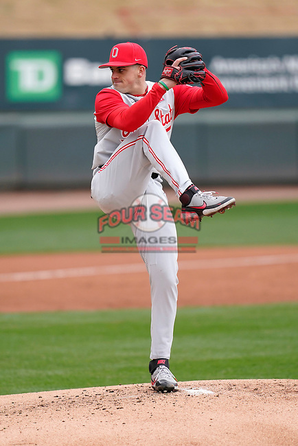 Starting pitcher Seth Lonsway (11) of the Ohio State Buckeyes delivers a pitch in a game against the Illinois Fighting Illini on Saturday, March 6, 2021, at Fluor Field at the West End in Greenville, South Carolina. (Tom Priddy/Four Seam Images)