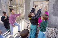 - Milano, bambini giocano in un cortile del quartiere Stadera, periferia sud della città....- Milan, children play in a court of the Stadera district, southern suburbs of the city