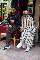 Essaouira, Morocco.  Modern and Traditional Clothing Styles.