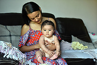 """Pictured: Cherelle Farrugia, aged 25, with her daughter, Willow, aged 6 months.<br />Re: A young mum became allergic to water after giving birth has described how the rare condition has made her life a """"nightmare"""".<br />Cherelle Farrugia, from Cardiff, south Wales gave birth to baby Willow in November 2017 but after six weeks she developed a painful rash every time she had a shower.<br />It took three months for doctors to diagnose her with aquagenic urticaria, a condition which leads to hives developing rapidly after the skin comes into contact with water.<br />The Cardiff and Vale College student is unable to take her daughter swimming and even has to cover up when it rains.<br />There is currently no cure for the severe allergy which is thought to have affected just 35 people worldwide but doctors believe it is linked to changes in Cherelle's hormones after giving birth to Willow."""