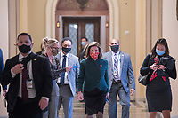 Speaker of the United States House of Representatives Nancy Pelosi (Democrat of California) walks from the House chamber to her office during a vote at the U.S. Capitol in Washington, DC, Monday, December 28, 2020. The House of Representatives convenes for a veto override vote on the National Defense Authorization Act (NDAA). Credit: Rod Lamkey / CNP/AdMedia