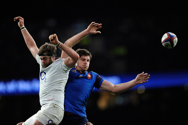 Alexandre Flanquart of France and Geoff Parling of England compete in the lineout