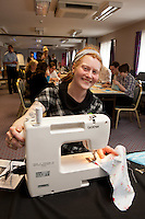 Staff experienced an unsual induction training day for the soon to be opened Derby Hobbycraft store. Here, Bea Brown trys her hand on the sewing machine.