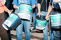 People hold buckets for donations to Mass Peace Action as people gather in Cambridge Common for a Tax Day protest near Harvard Square in Cambridge, Mass., on Sat., April 15, 2017. The demonstrators called for President Donald Trump to release his tax returns. Trump refused to release his tax returns during the 2016 presidential campaign, in contrast to all previous major party presidential candidates, and continues to refuse to release them. The protest was part of a larger movement nationwide called Tax March.