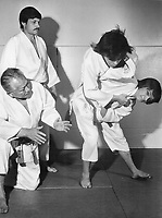 It's all in a judo family: Dieter Nadolny (top left), 38, watches son Harry, 15, throwing Andy, 16, as instructor Frank Hatashita scrutinizes the action. <br /> <br /> The Nadolny family has been taking judo together for the past 8 1/2 years and last night, at a ceremony at Hatashita Judo Club, all three became recipients of a black belt.<br /> <br /> The two younger Nadolnys have won 60 medals and cups in various judo competitions in North America.<br /> <br /> <br /> Griffin, Doug<br /> Picture, 1973