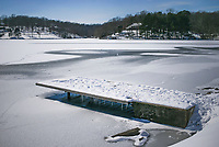 A snow covered dock is shown over a frozen lake, Thursday, February 18, 2021 at Tanyard Creek in Bella Vista. Check out nwaonline.com/210219Daily/ for today's photo gallery. <br /> (NWA Democrat-Gazette/Charlie Kaijo)