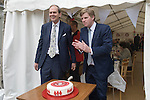The Earl of Sandwich. John the 11th Earl of Sandwich and his son, The Hon Orlando Montagu on the occasion of the 250 anniversary of the sandwich. Sandwich Kent. UK They have just cut the celebration cake.