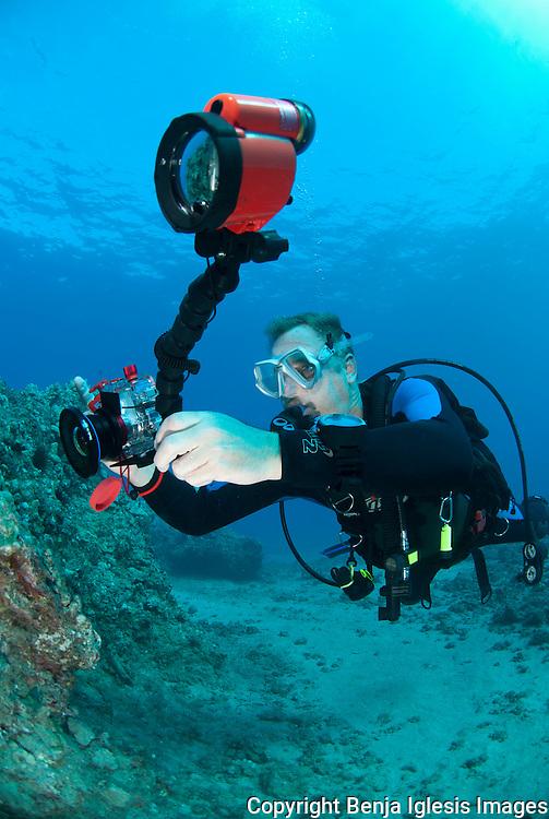 Underwater photographer at Nahuna Point Maui Hawaii.