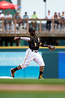 Pittsburgh Pirates second baseman Josh Harrison (5) throws to first during a Spring Training game against the Toronto Blue Jays  on March 3, 2016 at McKechnie Field in Bradenton, Florida.  Toronto defeated Pittsburgh 10-8.  (Mike Janes/Four Seam Images)