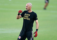WASHINGTON, DC - SEPTEMBER 12: Preston Burpo of the New York Red Bulls helps the goalkeepers warm up during a game between New York Red Bulls and D.C. United at Audi Field on September 12, 2020 in Washington, DC.