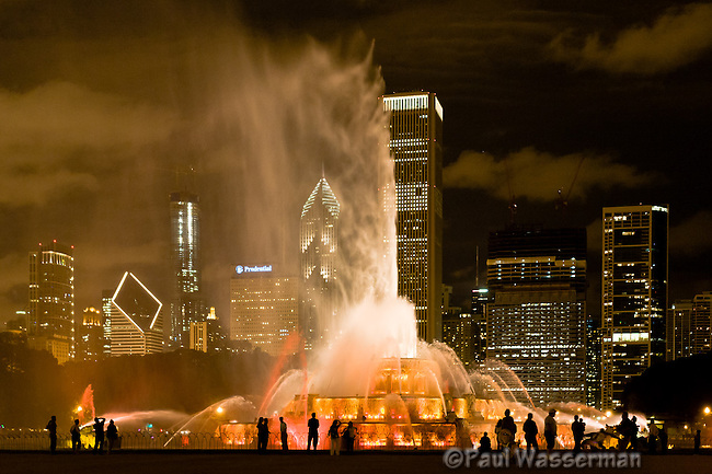People crowd around Chicago's Buckingham Fountain for the nightime light show