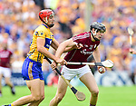 Peter Duggan of Clare in action against Joseph Cooney of Galway during their All-Ireland semi-final replay at Semple Stadium,Thurles. Photograph by John Kelly.