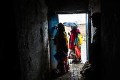 The Polio vaccinator marks the visited house during a house to house polio vaccination drive in Basantpur Sainthly village in Ghaziabad, Uttar Pradesh, India. <br /> The group of vaccinators usually comprises of the ANM (Auxiliary Nurse) and the local health workers in the village.