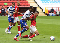 Josh Cullen of Charlton tries to shake off a challenge from Reading's Jordan Obita during Charlton Athletic vs Reading, Sky Bet EFL Championship Football at The Valley on 11th July 2020
