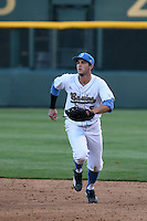 Sean Bouchard (5) of the UCLA Bruins in the field at first base during a game against the North Carolina Tar Heels at Jackie Robinson Stadium on February 20, 2016 in Los Angeles, California. UCLA defeated North Carolina, 6-5. (Larry Goren/Four Seam Images)