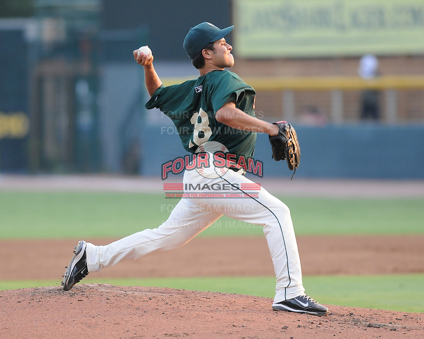 Pitcher Angel Cuan (18) of the Savannah Sand Gnats, Class A affiliate of the New York Mets, in a game against the West Virginia Power on July 21, 2011, at Grayson Stadium in Savannah, Georgia. (Tom Priddy/Four Seam Images)