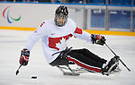 Sochi, RUSSIA - Mar 11 2014 -  Kevin Rempel controls the puck as Canada takes on Czech Republic in Sledge Hockey at the 2014 Paralympic Winter Games in Sochi, Russia.  (Photo: Matthew Murnaghan/Canadian Paralympic Committee)