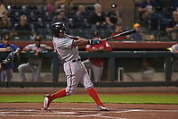 Mesa Solar Sox center fielder Victor Robles (14), of the Washington Nationals organization, follows through on his swing during an Arizona Fall League game against the Scottsdale Scorpions on October 23, 2017 at Scottsdale Stadium in Scottsdale, Arizona. The Solar Sox defeated the Scorpions 5-2. (Zachary Lucy/Four Seam Images)