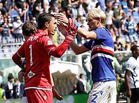 12th September 2021; G.Ferraris Stadium, Genoa, Italy; Serie A football, Sampdoria versus Inter Milan; Emil Audero of Sampdoria congratulates team mate Morten Thorsby of Sampdoria at the end of the match