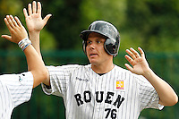 19 August 2012: Boris Marche of the Rouen Huskies is congratulated after scoring a run during the 12-8 win over Senart, during game 4 of the French championship finals, in Rouen, France. The Rouen Huskies win their 9th title in 10 years.
